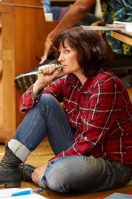 Katherine Toy sat on the floor