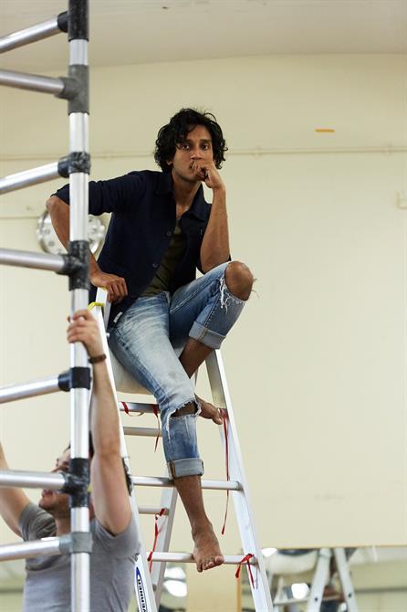 Assad Zaman sitting on a ladder