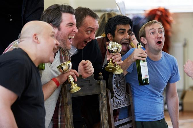 Byron Mondahl, Simon Yadoo, Christopher Middleton, Bally Gill and Jon Trenchard laughing and chanting