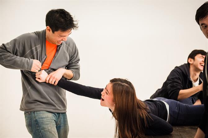 Kevin Shen grabbing Katie Leung's arm