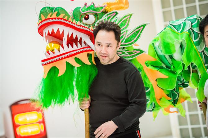 Daniel York holding a dragon