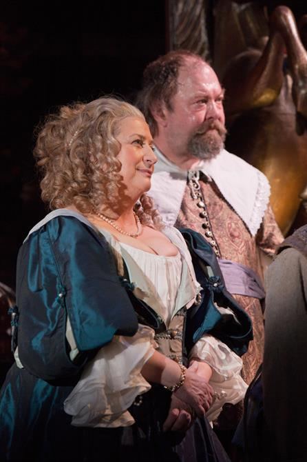Caroline Quentin in a period dress standing next to Mark Addy