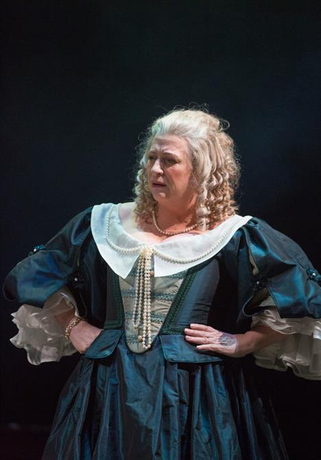 Caroline Quentin stands with her hands on her hips with a disgusted look on her face