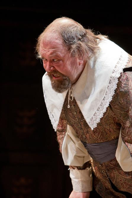 Mark Addy bant over slightly looking a bit angry