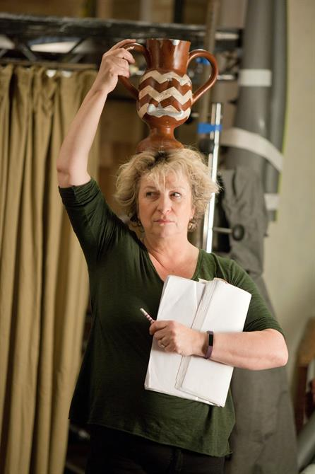 Caroline Quentin holding a vase on her head