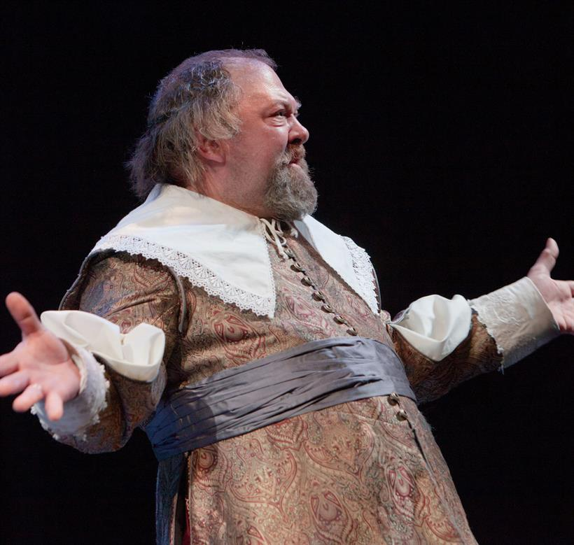 Mark Addy on stage with his arms out