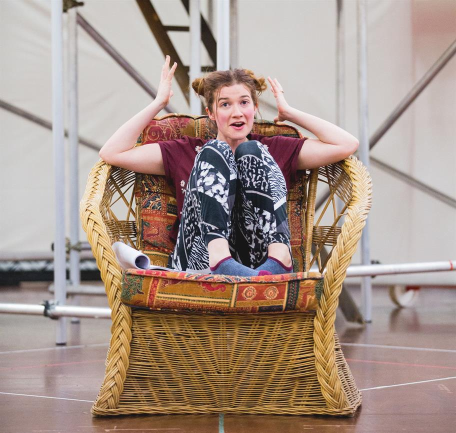Karen Fishwick rehearsing as Juliet, sat in a large wicker chair.