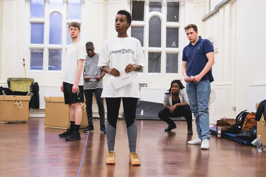 A young woman and two young men rehearsing