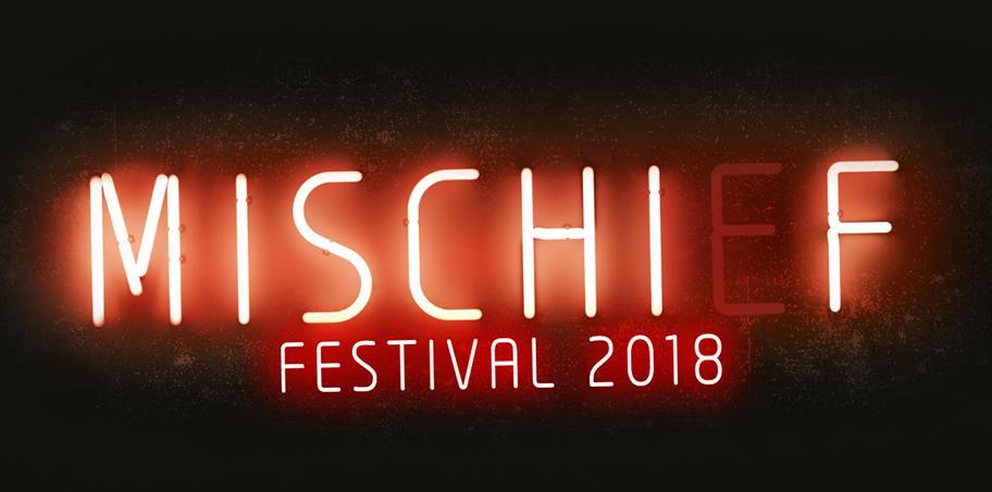 Mischief Festival 2018 written in orange neon on a black background