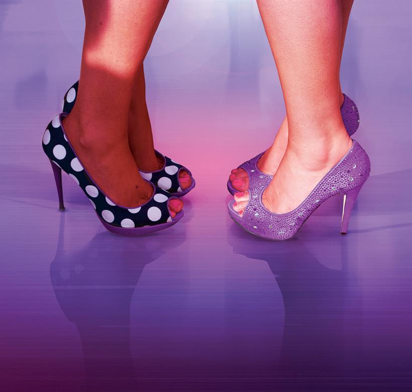Two pairs of legs in stilettos