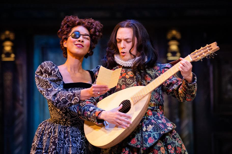 A woman in an eye patch sings as a man plays the lute.