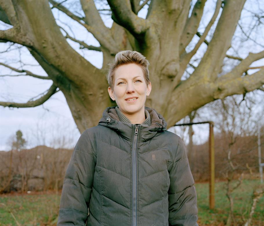 Maria Aberg standing in front of a tree