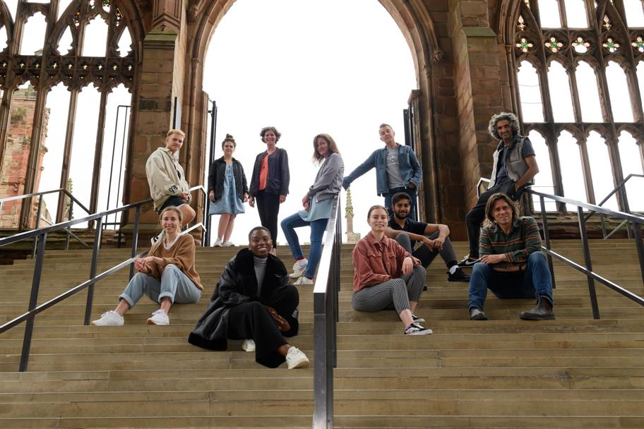Cast and creatives of Faith posing in Coventry Cathedral.