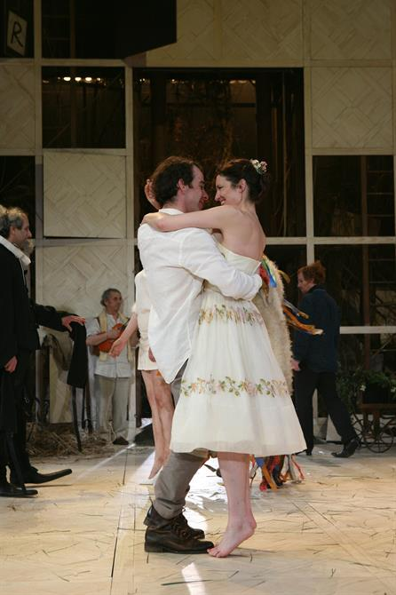 Katy Stephens and Jonjo O'Neill in As You Like It, both wearing white and embracing each other