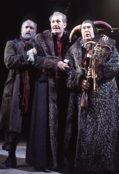 Bearded man, elderly man in fur-trimmed overcoat and fool with jester hat and mini-fool stick