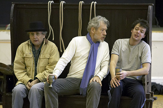 Sylvester McCoy, Ian McKellen, Ben Meyjes in rehearsal for the stable scene. They're sitting on a practice 'settle' - a high-backed bench.