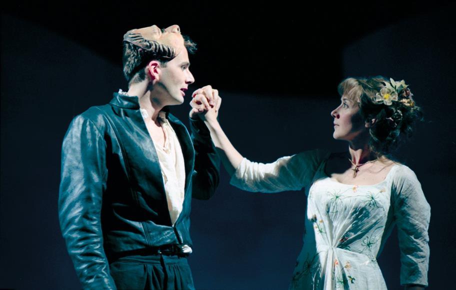 Romeo (David Tennant) falls in love with Juliet Alexandra Gilbreath) at the Capulets' ball.