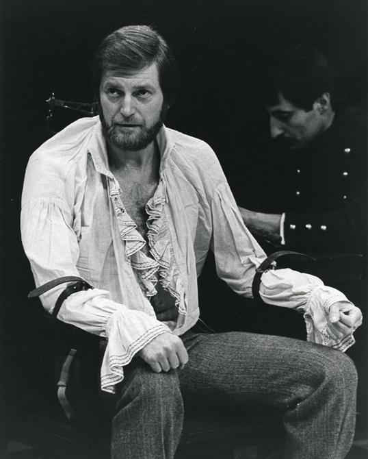 Antonio in the trial scene, with his arms tied to the chair