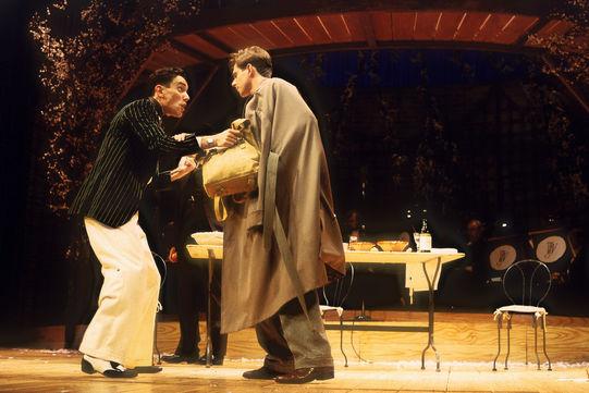 Proteus (Ben Miles) tells Valentine (Dominic Arnold) to flee in The Two Gentlemen of Verona 1993