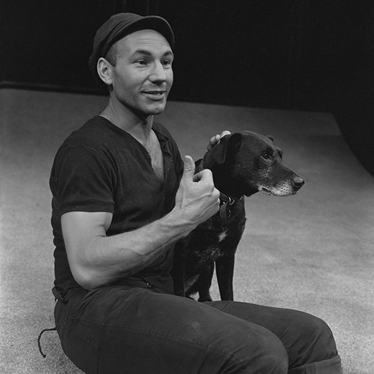 Patrick Stewart playing Lance, stroking his dog Crab
