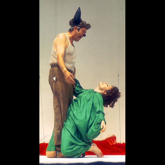 Titania (Sara Kestelman) swoons in the arms of Bottom (David Waller) before they both fall asleep in her bower.