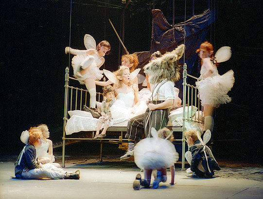 In the metal bedstead which formed her bower, Titania (Clare Higgins) introduces Bottom (David Troughton) to her fairies.