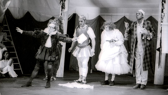 The mechanicals stage their play. Left to right: Quince (Paul Webster), Bottom/Pyramus (David Troughton), Flute/Thisbe (Graham Turner), Starveling/Moonshine (Dhobi Operei).