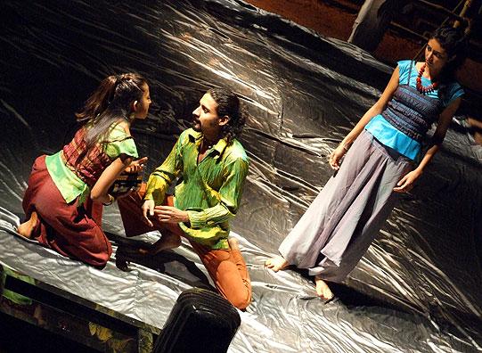 Helena (Shanaya Rafaat) enters and Hermia (Yuki Ellias) tells her that she will run away with Lysander (Chandan Roy Sanyal).