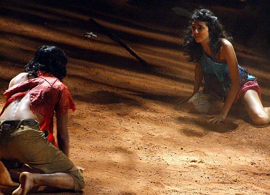 Helena (Shanaya Rafaat) chases Demetrius (Prasanna Mahagamage).