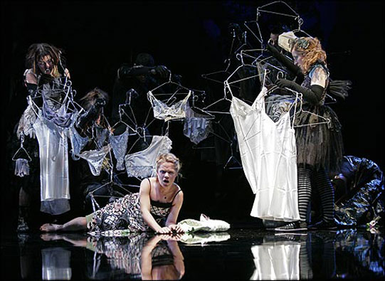 Hermia waking up in a forest of underwear and coathangers