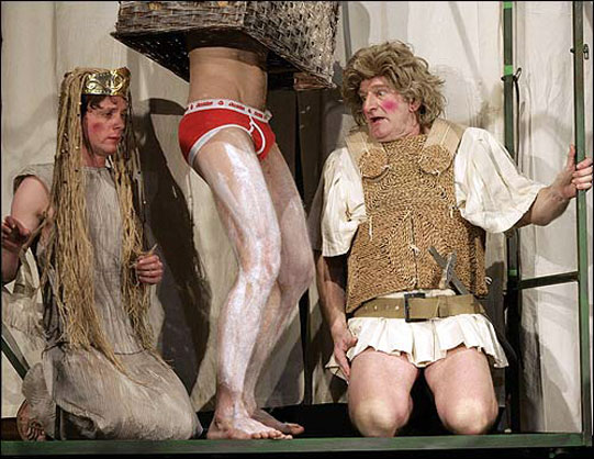 Pyramus and Thisbe, with 'the wall' in between, wearing bright red Y-fronts