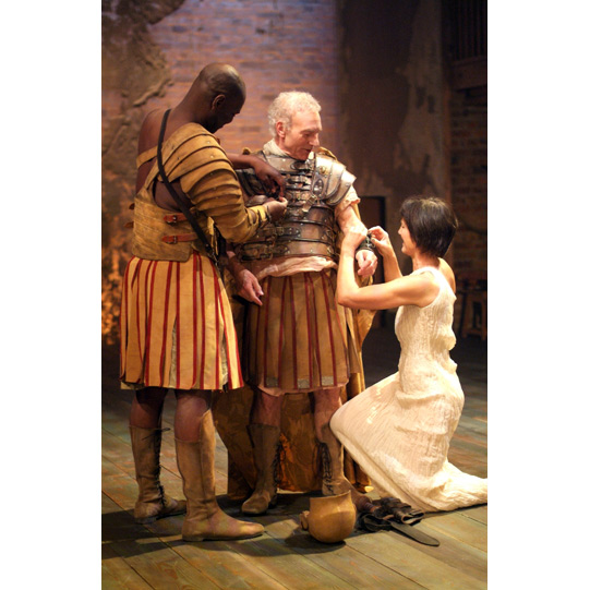 Cleopatra and Eros help Antony put on his armour.