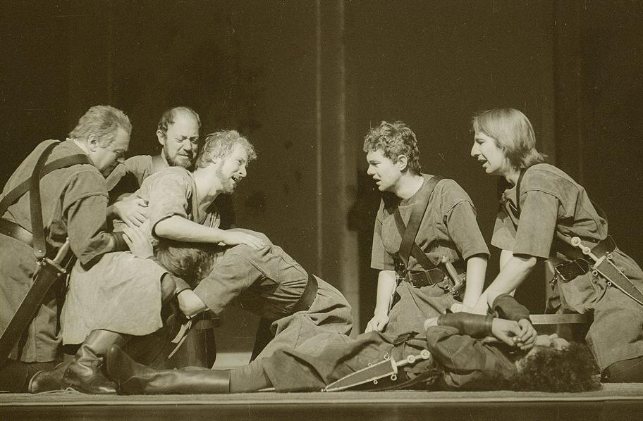 A scene from the 1978 production of Antony and Cleopatra, where a group of Roman soldiers in military uniform are in discord