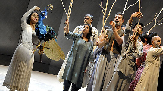 Actor Ayesha Dharker, playing Shahrazad, shows the talking bird