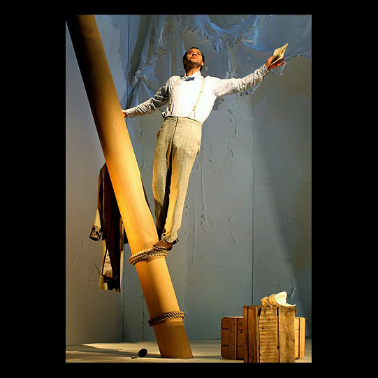 Antipholus of Syracuse (Joe Dixon) climbs a mast in Ephesus. Katrina Lindsay's set design mirrorred the shipwreck storyline with its tall masts, battered wooden chests and torn sails.