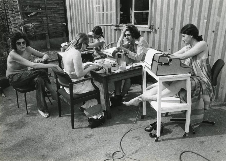 Five RSC staff working outside a corrugated steel structure (The Other Place) one summer in  the 1970s