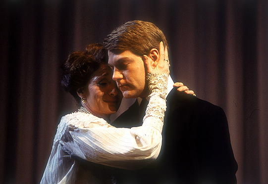 Woman embraces man on stage