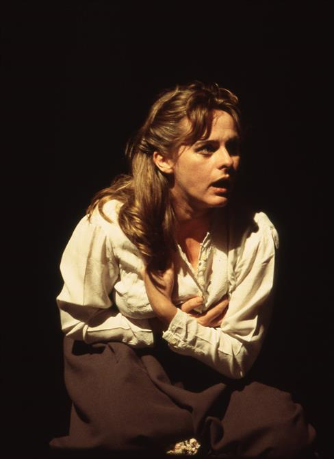 Ophelia (Joanne Pearce) clutches her chest after being assaulted by Hamlet