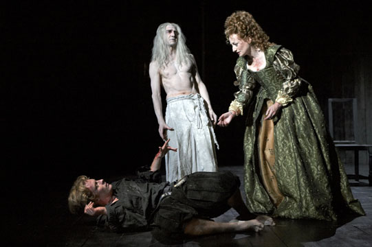 Hamlet lies on the floor with his Mother standing over him. Ghost Hamlet stands on stage too