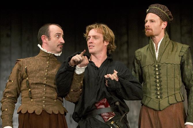 Hamlet stands between Rosencrantz and Guildenstern
