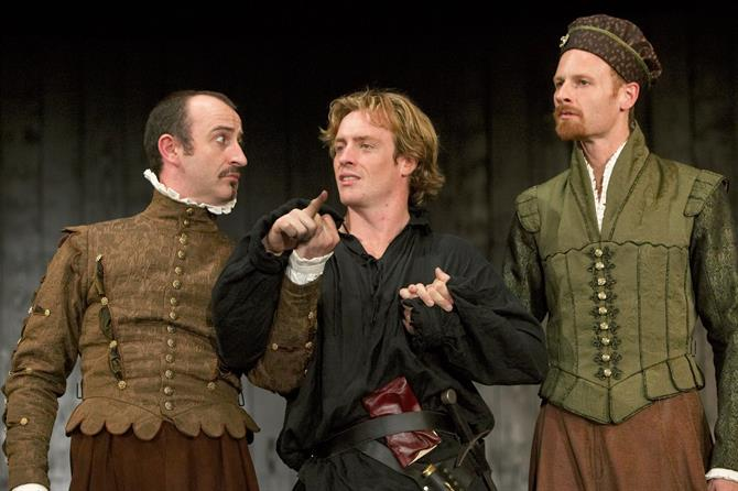 Hamlet stands between Rosencrantz and Guildenstern