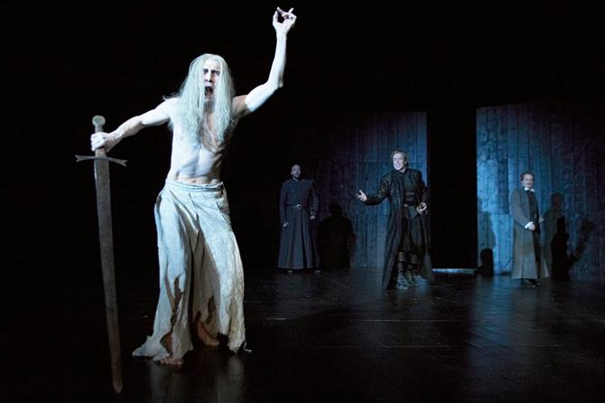 The Ghost of the old King Hamlet appears with long white hair and ragged white trousers at night to Hamlet, Horatio and Marcellus.