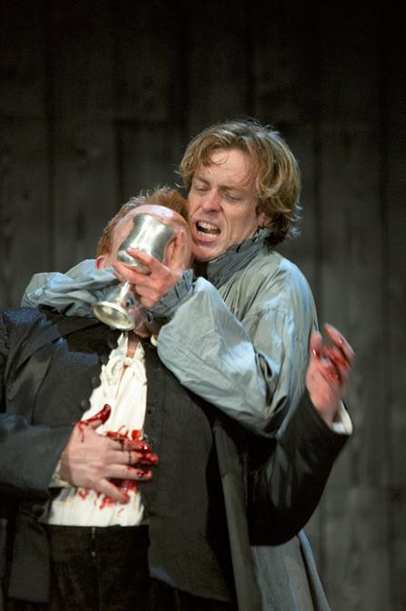 Hamlet forces a wounded Claudius to drink out of the poisoned wine cup