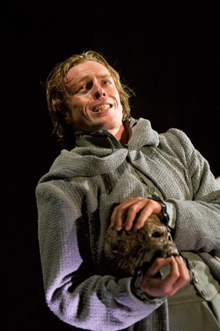 Hamlet holds a skull in his hands