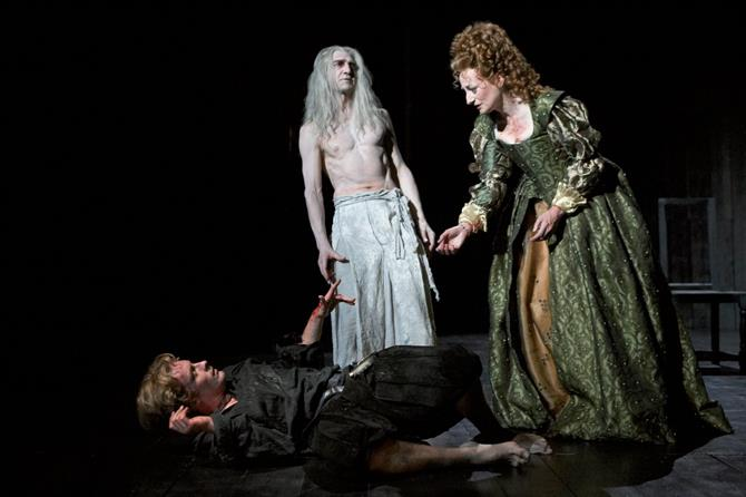 Hamlet lies on the floor with his mother standing over him. Ghost Hamlet stands on stage by them