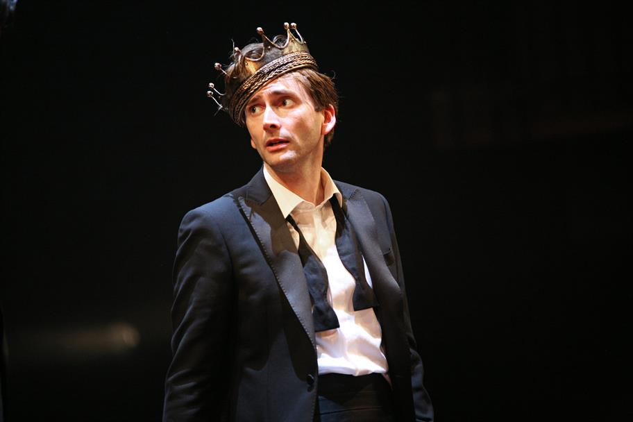 Hamlet (David Tennant) stands on stage.
