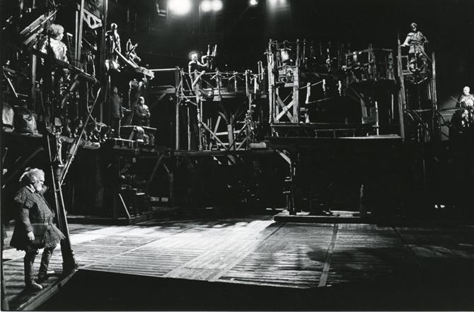 Production photo showing John Napier's timbered set for Henry IV Part 1 1982 at the Barbican Theatre