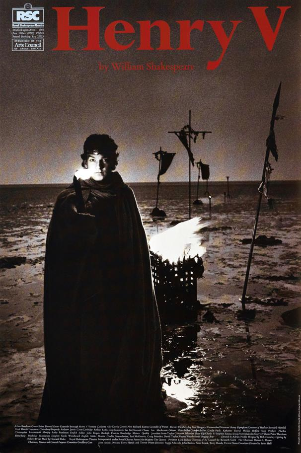 Theatrical poster featuring a night scene with a young man in long cloak in front of a brazier in a muddy field