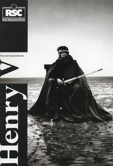Theatre programme cover for Henry V 1984 featuring Kenneth Branagh sitting on throne in muddy field