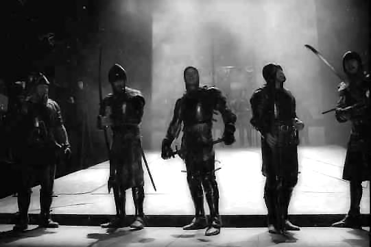 Soldiers on stage ready for battle